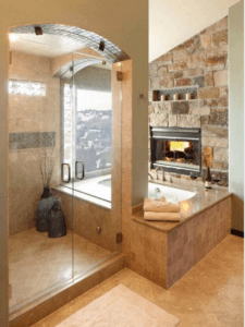 interior & design llc Master Bathroom with whirlpool & fireplace